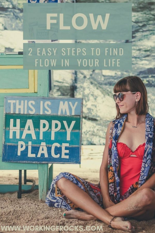 "Image of a woman sitting on a beach. She has a fringe/bangs, a red swimming costume and a short kimono on. She is sitting by a small beach shack with a sign that says, ""This s my happy place"". The blog post is about flow."