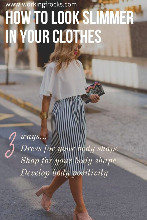 The post is for how to dress for your body shape. Woman walking down the street.  She is wearing a white cropped top with short sleeves, and a skirt with vertical stripes in navy and white.  She holds a clutch bag under her arm and has long blond slightly wavy hair.  She is wearing open toed high heel mules
