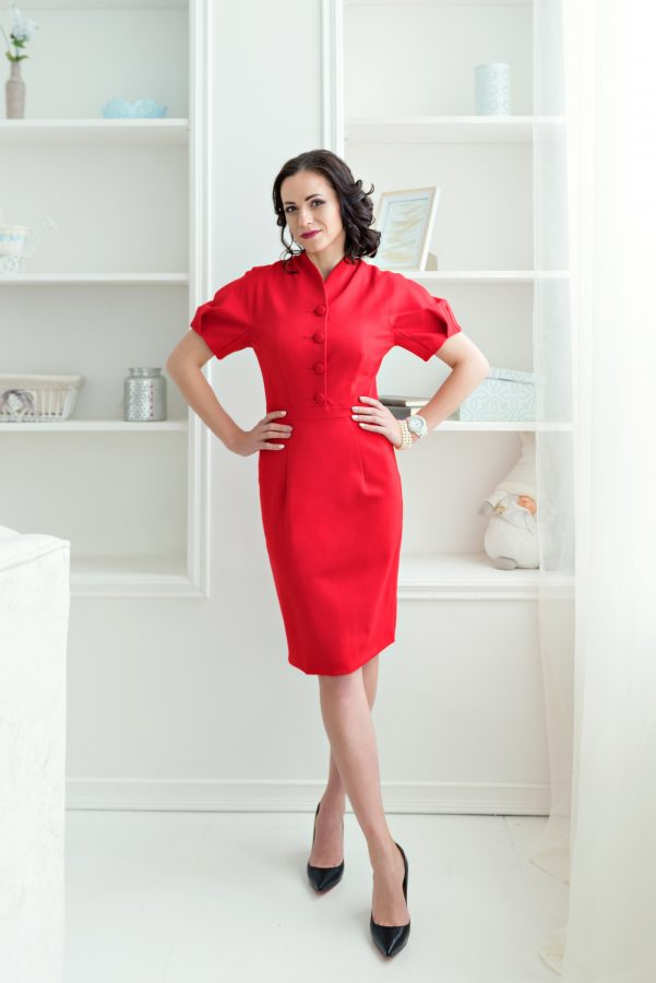 Woman in smart red dress working from home