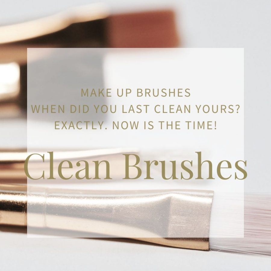 Make up brushes with white bristles and bronze colour metal tips