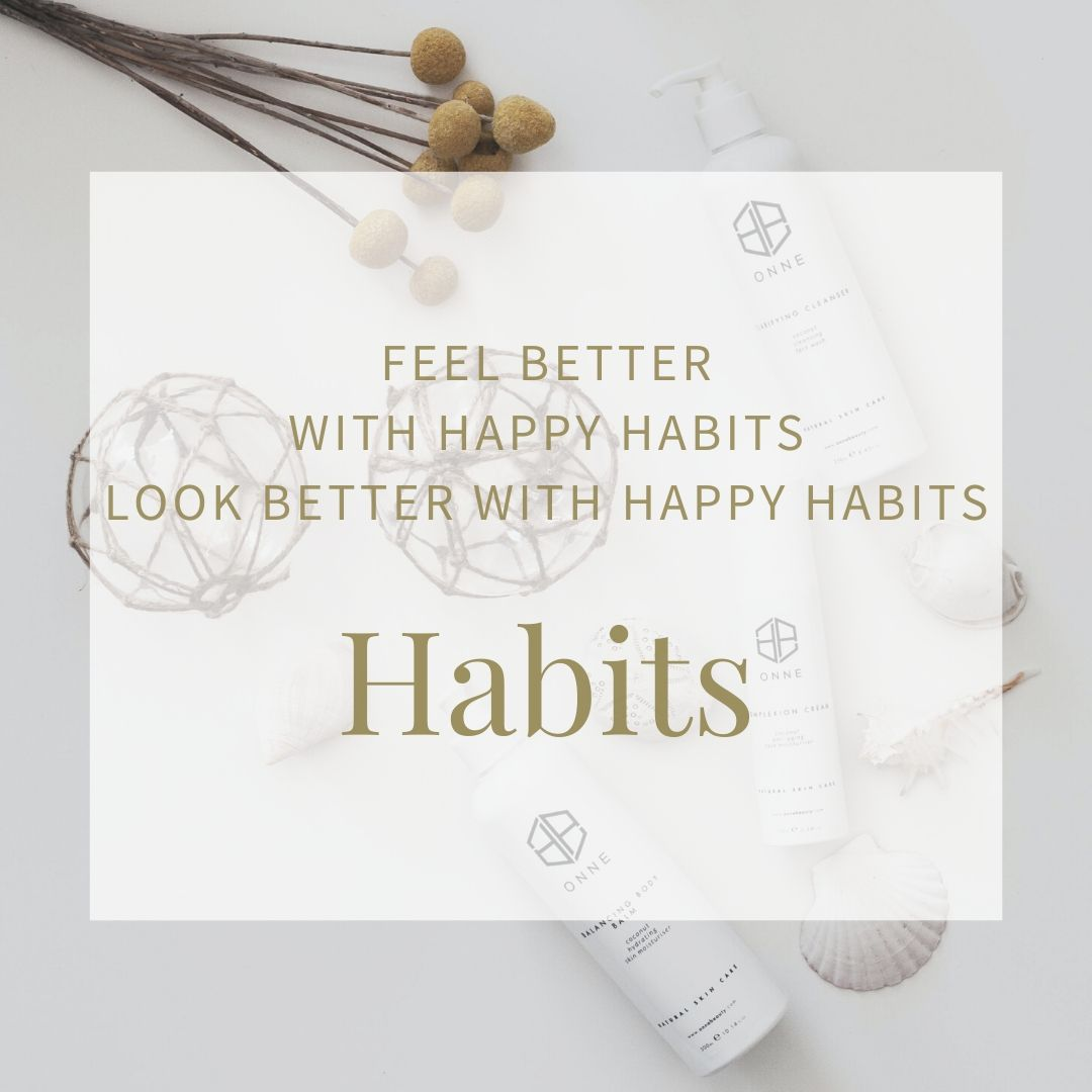 Background image of moisturiser bottles intended to show the power of habit