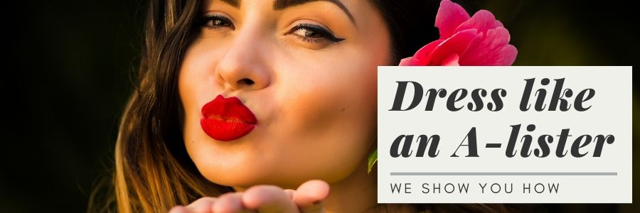Beautiful latin woman with red lipstick and eye make up, forming a kiss to the camera