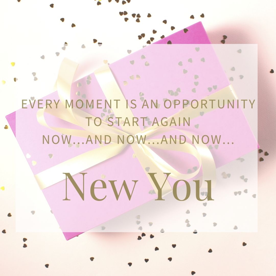 "Gift box wrapped in bright pink paper with a gold bow to signify ""New You"""