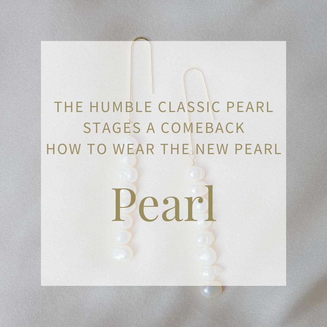 image of a pair of modern pearl earrings. The hooks are a simple gold wire and there are 7 pearls which drop down as a pendant. The blog title is Pearl