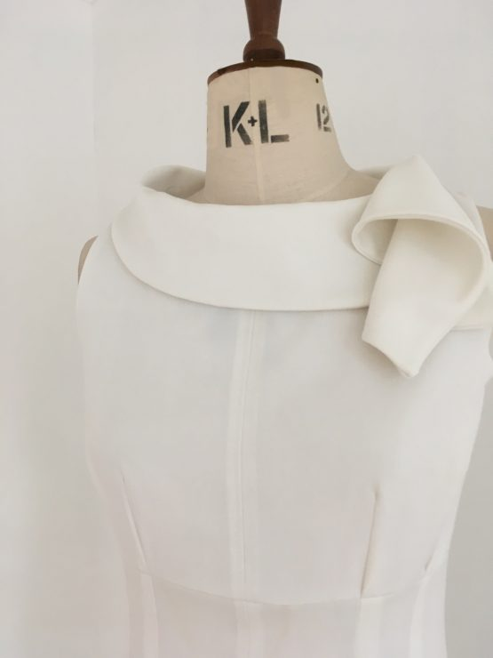 Dresses for your working day - Adventure - Close up - White sleeveless dress with draped collar. Autumn Winter 2020. Part lined.