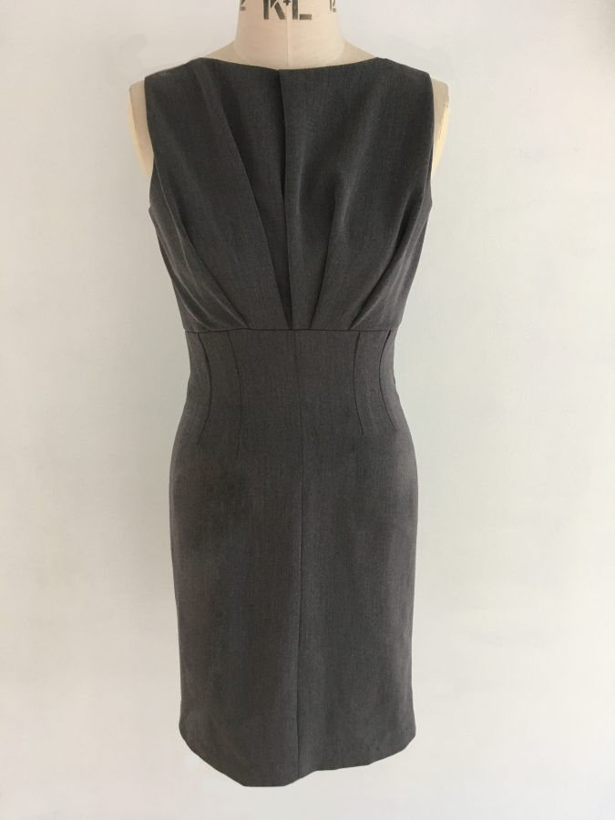 Easy to wear Courage Dress grey mixed fibre dress with pleated bodice, raised waistline and fitted skirt. Half lined.
