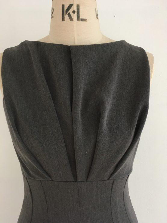 Courage Dress grey mixed fibre dress with pleated bodice, raised waistline and fitted skirt. Half lined.