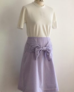 gingham skirt with bow tie and black stitched leaf motif